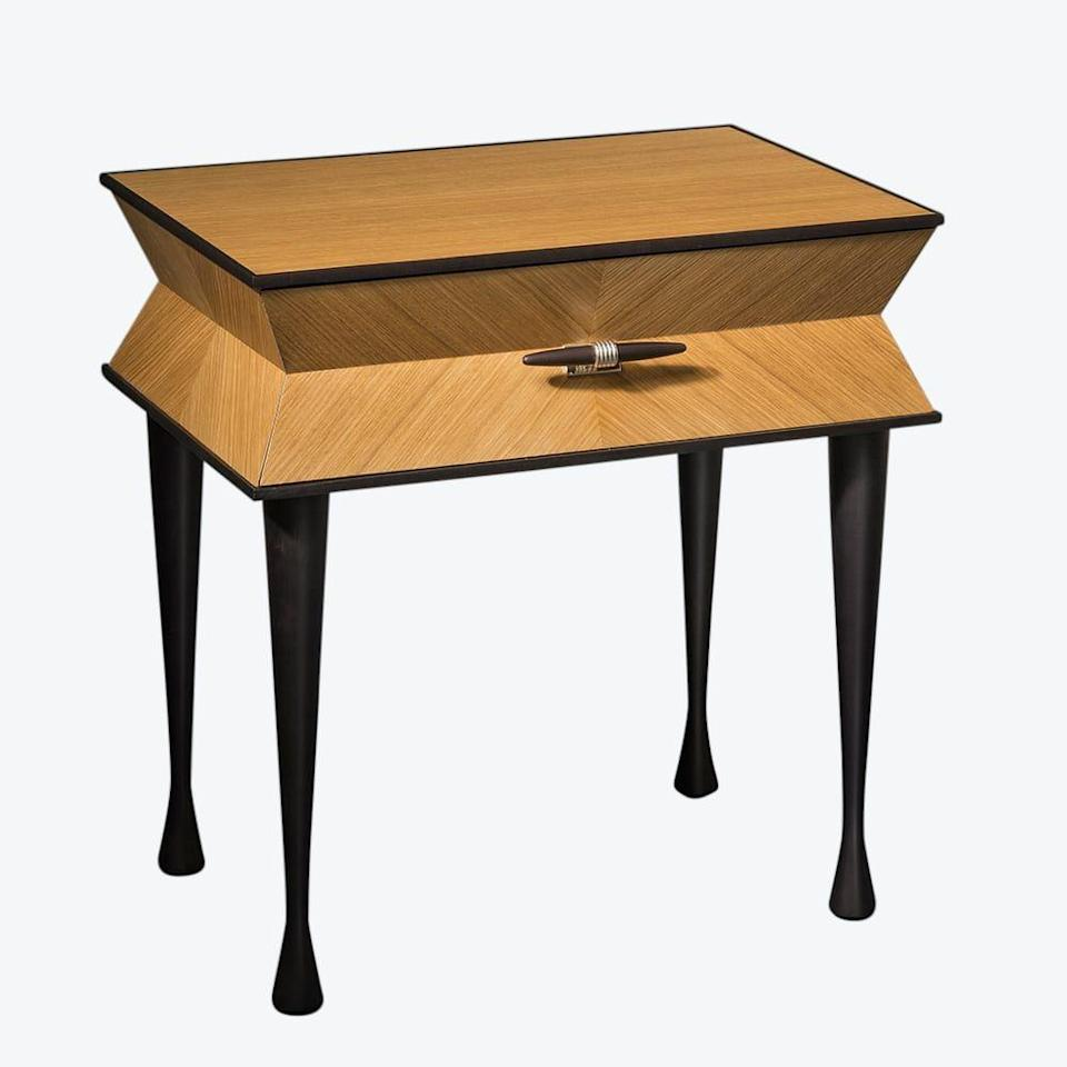 """<p><strong>Pinto Paris</strong></p><p>theinvisiblecollection.com</p><p><a href=""""https://theinvisiblecollection.com/product/pinto-paris-vanity-bedside-table/"""" rel=""""nofollow noopener"""" target=""""_blank"""" data-ylk=""""slk:Shop Now"""" class=""""link rapid-noclick-resp"""">Shop Now</a></p><p>Natural oak and ebonized cherry are in perfect harmony in this stunning bedside table.<br></p>"""