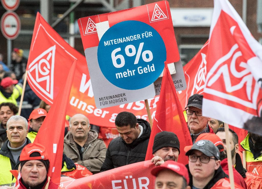 If no progress is made on their wage demands, IG Metall workers, such as those seen here joining a warning strike in Cologne, could join a series of 24-hour walkouts, raising the prospect of a first open-ended stoppage since 2003 (AFP Photo/Federico Gambarini)