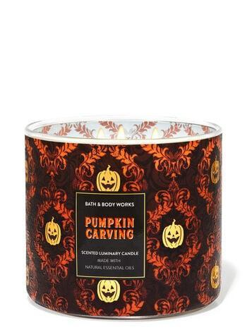 <p>Get whiffs of freshly carved pumpkins, spiced pumpkin seeds, and smooth brown sugar in this three-wick <span>Bath &amp; Body Works Pumpkin Carving Candle</span> ($25), made with essential oils.</p>