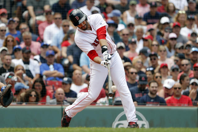 Boston Red Sox's J.D. Martinez connects on a solo home run against the Toronto Blue Jays during the fourth inning of a baseball game Saturday, July 14, 2018, in Boston. (AP Photo/Winslow Townson)