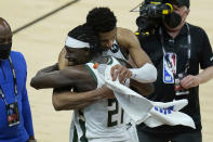 Milwaukee Bucks forward Giannis Antetokounmpo, top, celebrates with guard Jrue Holiday (21) after the Bucks defeated the Phoenix Suns in Game 5 of basketball's NBA Finals, Saturday, July 17, 2021, in Phoenix. (AP Photo/Ross D. Franklin)