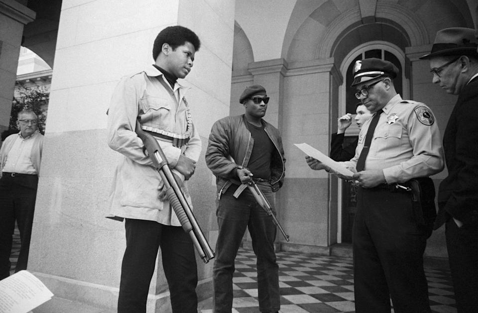 Two members of the Black Panther Party with Ernest Holloway