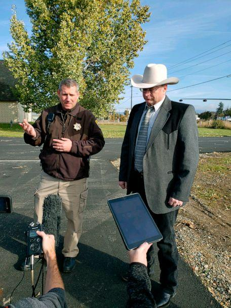 PHOTO: Lewis and Clark County Undersheriff Jason Grimmis, left, and Sheriff Leo Dutton, right, update reporters on a homemade bomb that detonated in an elementary school playground on Oct. 15, 2019, in Helena, Mont. (Amy Beth Hanson/AP)