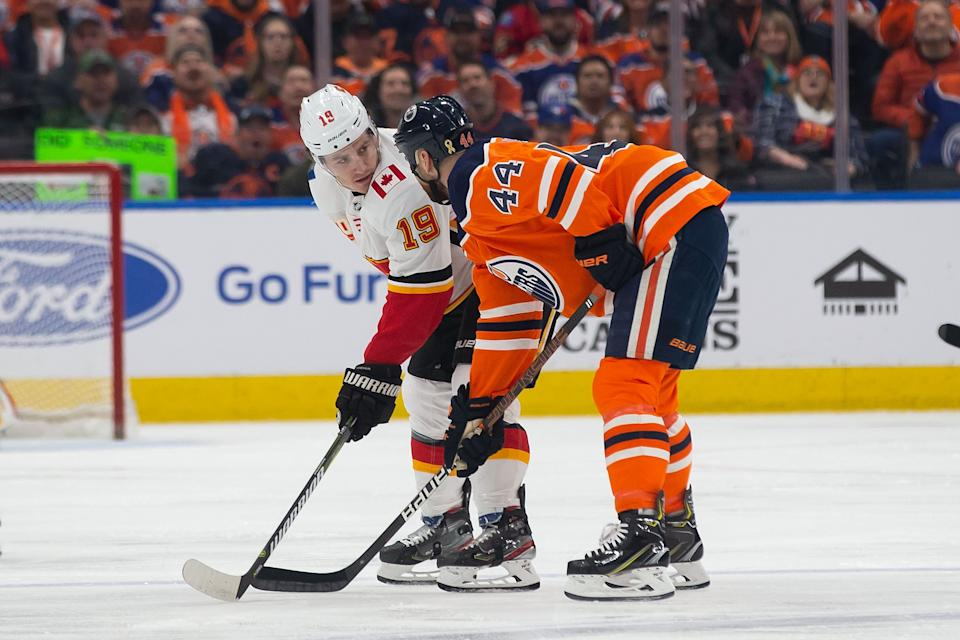EDMONTON, AB - JANUARY 29: Zack Kassian #44 of the Edmonton Oilers has a discussion with Matthew Tkachuk #19 of the Calgary Flames at Rogers Place on January 29, 2020, in Edmonton, Canada. (Photo by Codie McLachlan/Getty Images)
