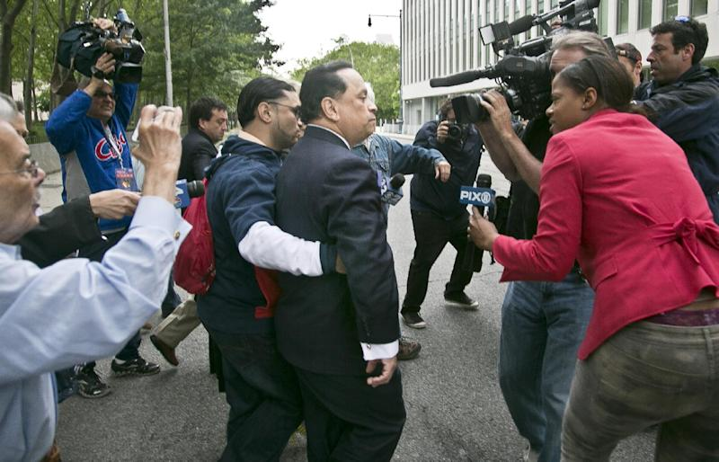 Former state Sen. Pedro Espada Jr., center, arrives at Brooklyn federal court on Friday, June 14, 2013 in New York. Espada Jr. could face seven years in prison after pleading guilty to tax fraud charges. The once-influential politician also was convicted in a separate case alleging he looted taxpayer-subsidized health clinics. Espada operated the clinics in the South Bronx for three decades until prosecutors accused him of turning the network into a personal ATM. (AP Photo/Bebeto Matthews)