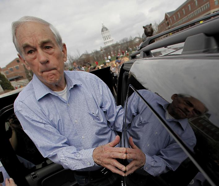 Republican presidential candidate, Rep. Ron Paul, R-Texas leaves after a rally at the University of Missouri, Thursday, March 15, 2012, in Columbia, Mo. (AP Photo/Charlie Riedel)