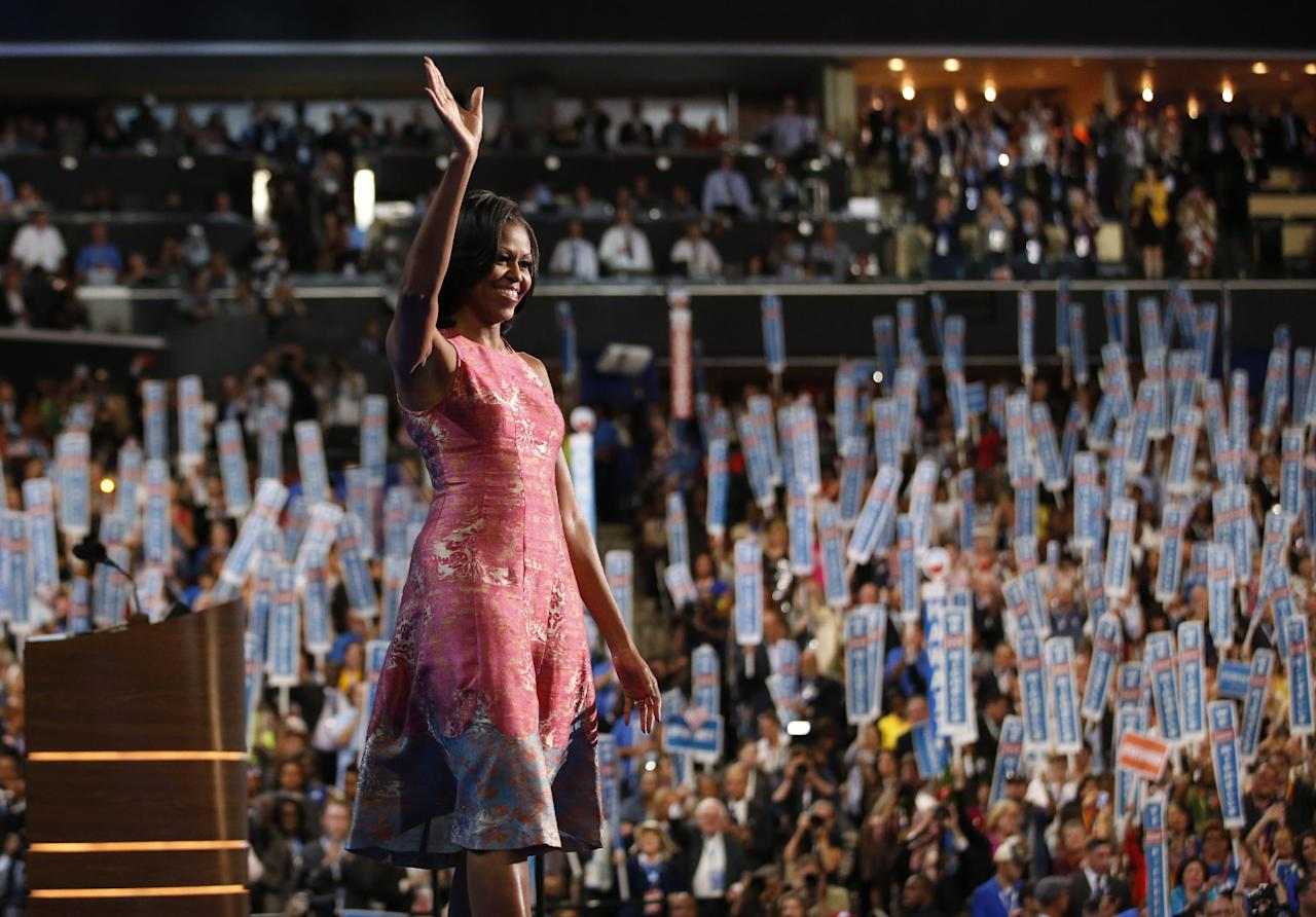 First lady Michelle Obama waves after addressing the Democratic National Convention in Charlotte, N.C., on Tuesday, Sept. 4, 2012. (AP Photo/Jae C. Hong)