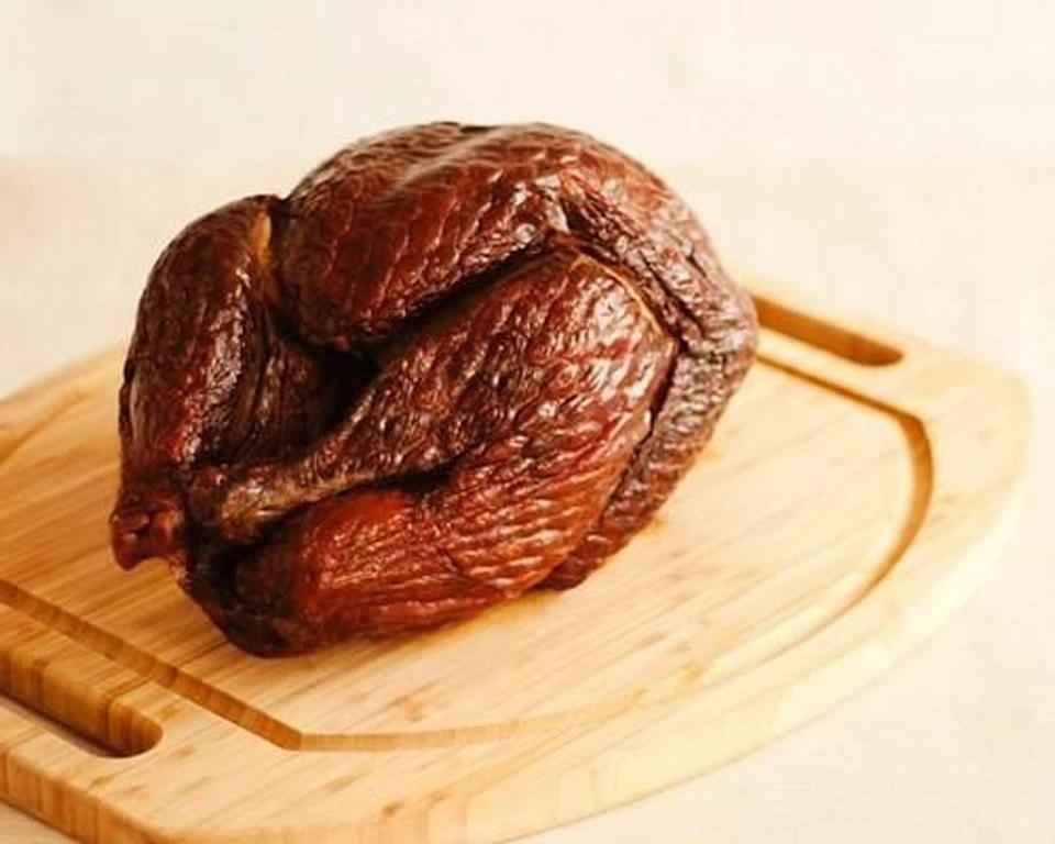 """<p>Soaking chunks of a fruit wood or hickory the night before cooking is the key to a good smoked turkey, as is starting <i>very</i> early on Thanksgiving morning. <a href=""""https://www.yahoo.com/food/how-to-smoke-a-turkey-103045179796.html"""" data-ylk=""""slk:Learn how to smoke a turkey here.;outcm:mb_qualified_link;_E:mb_qualified_link;ct:story;"""" class=""""link rapid-noclick-resp yahoo-link""""><b>Learn how to smoke a turkey here</b>.</a> <i> Photo: StockFood/Michael Marquand</i></p>"""