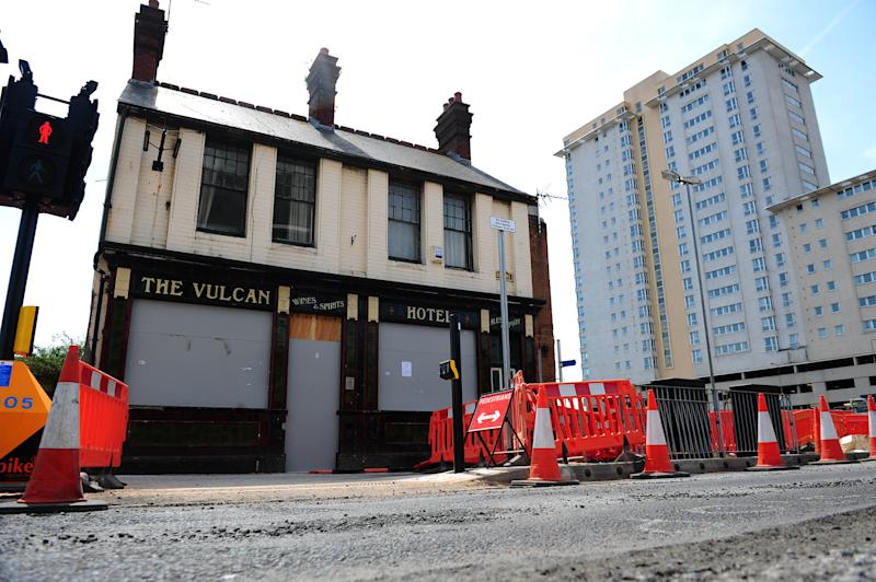A beloved pub was knocked down - and moved brick-by-brick ten miles to be rebuilt inside a MUSEUM. The Vulc<an pub served generations of boozers in Cardiff for more than 160 years only to be demolished for a shopper's car park. More than 5,000 campaigners signed a petition to save it - and now their wish will come true. Pictured here being rebuilt at St Fagans museum. © WALES NEWS SERVICE