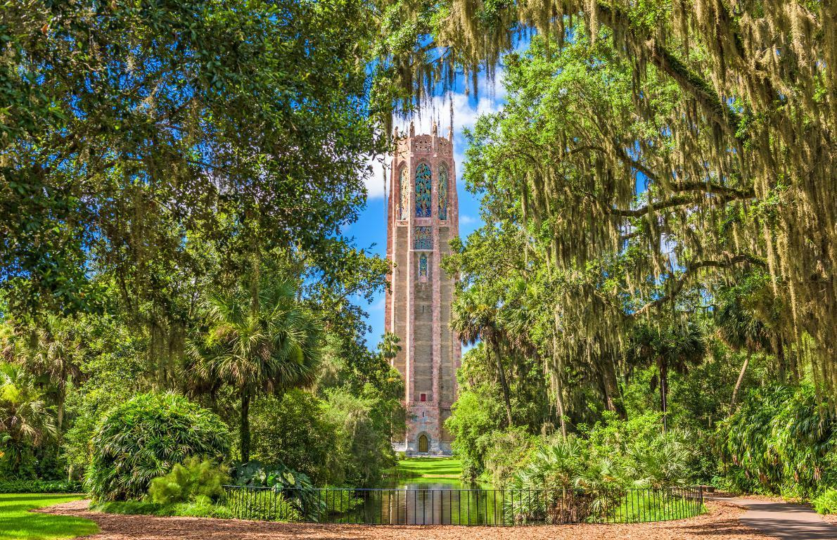 """<p>Bok Tower Gardens has a lush, 250-acre garden and a 205-foot-tall tower with carillon bells. The gorgeous gardens were a product of Edward W. Bok, former longtime editor of the popular women's magazine Ladies' Home Journal, and his wife, Mary Louise Curtis Bok's desire to create a bird sanctuary while they were spending a <a href=""""https://www.thedailymeal.com/travel/weird-florida-facts-gallery?referrer=yahoo&category=beauty_food&include_utm=1&utm_medium=referral&utm_source=yahoo&utm_campaign=feed"""" target=""""_blank"""">winter in Florida</a>. They chose an unusually elevated area of the flat state, a hill that rises 298 feet above sea level. Florida's subtropical conditions made it an ideal place to plant bushes and trees, which made it a perfect spot for 126 species of birds.</p> <p></p>"""