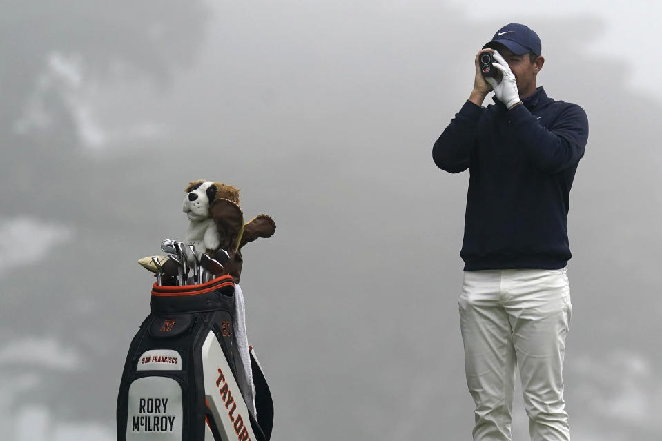 Rory McIlroy, of Northern Ireland, checks the yardage from the third tee during practice for the PGA Championship golf tournament at TPC Harding Park in San Francisco, Tuesday, Aug. 4, 2020. (AP Photo/Jeff Chiu)