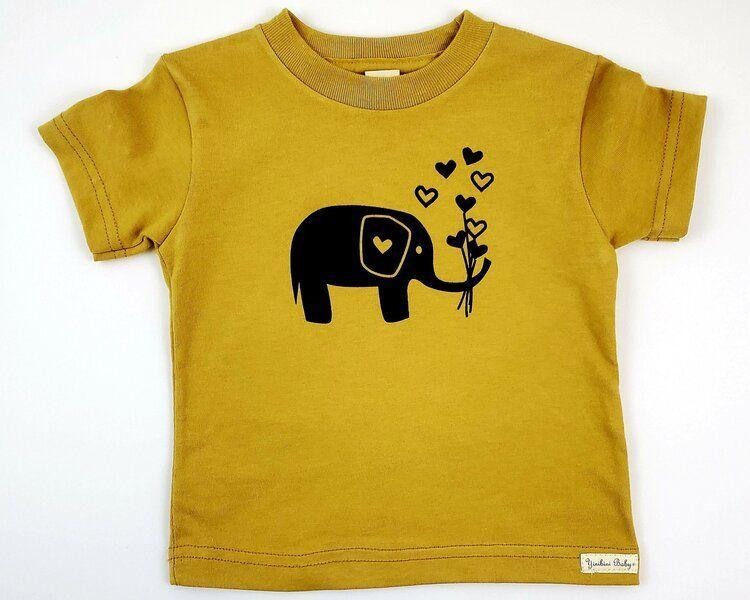 "<p><strong>Yinibini Baby</strong></p><p>yinibinibaby.com</p><p><strong>$26.00</strong></p><p><a href=""https://www.yinibinibaby.com/shop/elephant-tee"" rel=""nofollow noopener"" target=""_blank"" data-ylk=""slk:Shop Now"" class=""link rapid-noclick-resp"">Shop Now</a></p><p>Elephants always rank at the top of kids' favorite-animal lists, and this one has a Valentine's Day twist since it's holding a bouquet of hearts. This design comes in five colors up to sizes 4T.</p>"