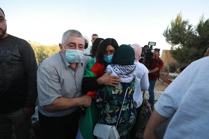 Palestinian lawmaker Khalida Jarrar visits her daughter's grave after she passed away at age 31 from a cardiac arrest 3 months ago,  after her release on Sunday  from an Israeli prison in Ramallah  where she was held for years  (Anadolu Agency via Getty Images)
