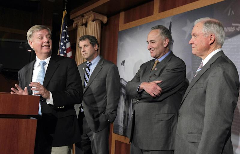 From left to right, Sen. Lindsey Graham, R-S.C., Sen. Sherrod Brown, D-Ohio, Sen. Chuck Schumer, D-N.Y., and Sen. Jeff Sessions, R-Ala., face reporters following a vote that clears the way for debate on a bill that would impose tariffs on Chinese imports as a penalty for currency manipulation Monday, Oct. 3, 2011, on Capitol Hill in Washington.  (AP Photo/J. Scott Applewhite)