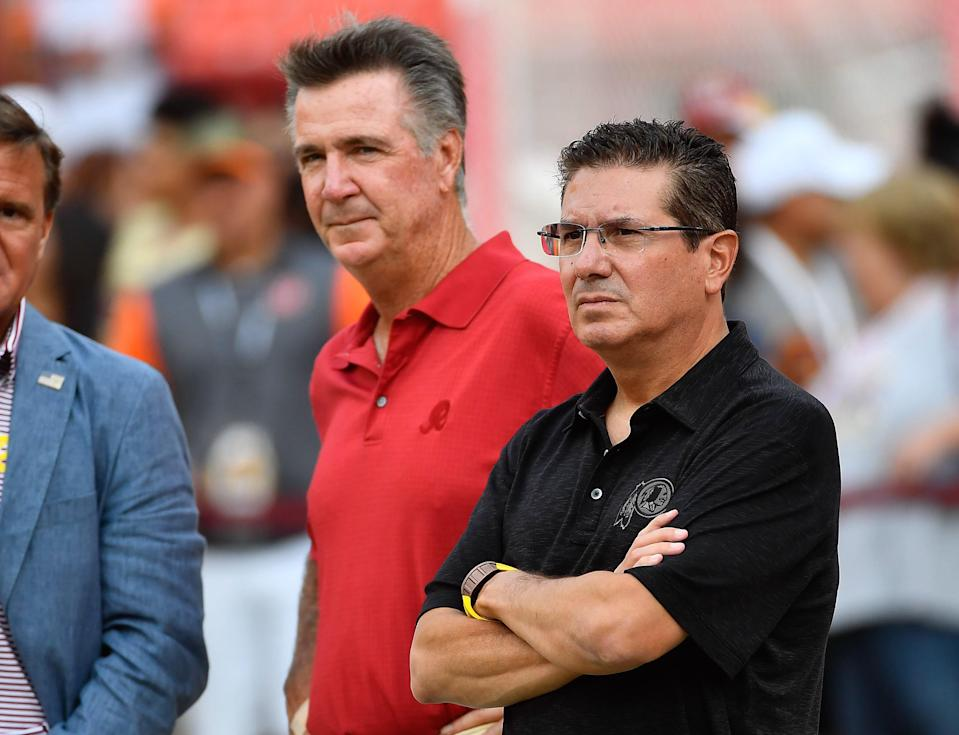 Former Washington Football Team president Bruce Allen (left) and team owner Daniel Snyder (right) on the field before the game against the Cincinnati Bengals at FedEx Field.
