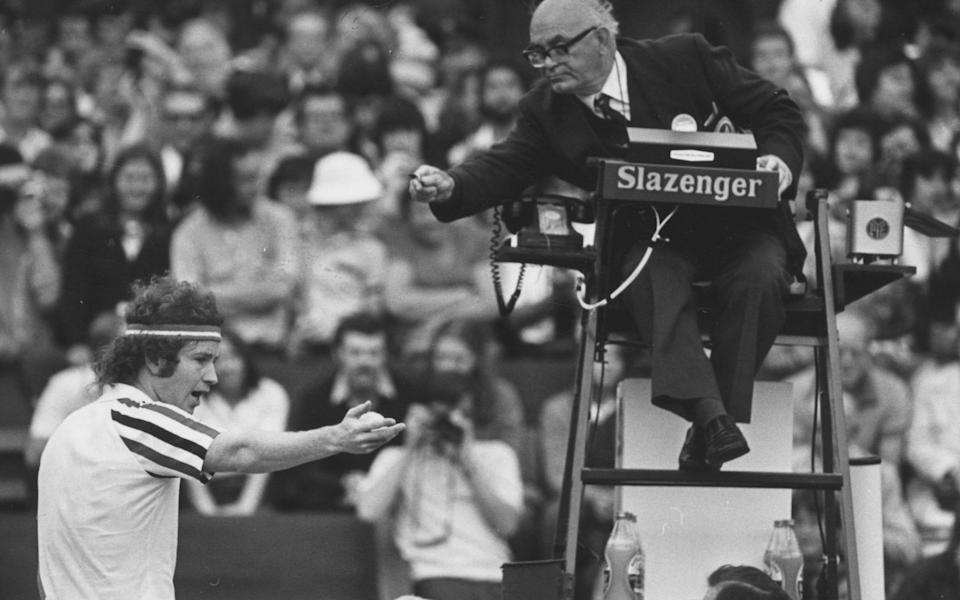 John McEnroe argues a point with the umpire during his semi-final match against Jimmy Connors in the men's singles at Wimbledon - HULTON ARCHIVE