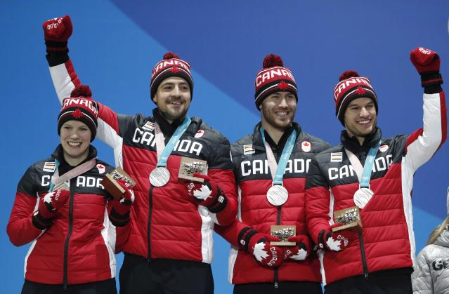 Medals Ceremony - Luge - Pyeongchang 2018 Winter Olympic Games - Team Relay - Medals Plaza - Pyeongchang, South Korea - February 16, 2018 - Silver medalists Alex Gough, Sam Edney, Tristan Walker and Justin Snith of Canada on the podium. REUTERS/Kim Hong-Ji