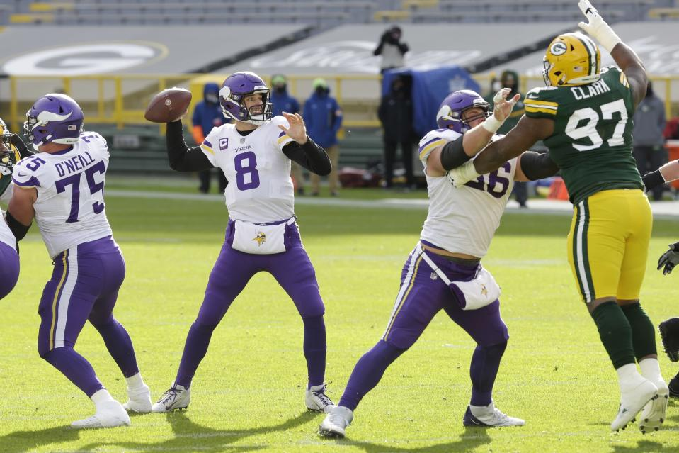 Minnesota Vikings' Kirk Cousins passes during the second half of an NFL football game against the Green Bay Packers Sunday, Nov. 1, 2020, in Green Bay, Wis. (AP Photo/Mike Roemer)
