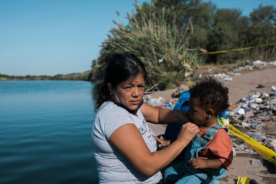 Customs and Border Protection mounted officers attempt to contain mostly migrants as they cross the Rio Grande from Ciudad AcuÒa into Del Rio, Texas, . Thousands of Haitian migrants have been