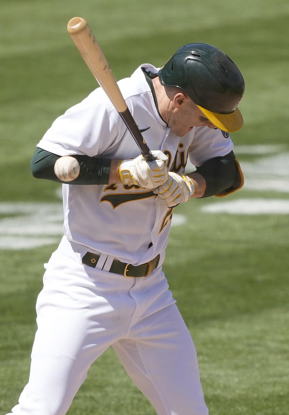 Oakland Athletics' Mark Canha (20) is hit by a pitch by Detroit Tigers pitcher Casey Mize during the fifth inning of a baseball game on Saturday, April 17, 2021, in Oakland, Calif. (AP Photo/Tony Avelar)
