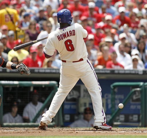 Philadelphia Phillies' Ryan Howard is hit by a pitch as he plays against the San Francisco Giants in the first inning of a baseball game on Sunday July 22, 2012, in Philadelphia. (AP Photo/H. Rumph Jr)