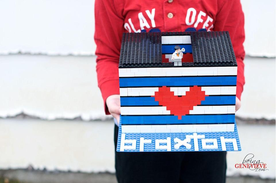 "<p>Who says card holders have to crafted from paper and glue? Kids can help build a box with their toy blocks!</p><p><strong>Get the tutorial at <a href=""http://beinggenevieve.com/lego-valentine-box/"" rel=""nofollow noopener"" target=""_blank"" data-ylk=""slk:Being Genevieve"" class=""link rapid-noclick-resp"">Being Genevieve</a>.</strong></p><p><strong><a class=""link rapid-noclick-resp"" href=""https://www.amazon.com/stores/LEGO/LEGO/page/017EF856-965D-4B56-A171-EA61CAFF45DD?tag=syn-yahoo-20&ascsubtag=%5Bartid%7C10050.g.25844424%5Bsrc%7Cyahoo-us"" rel=""nofollow noopener"" target=""_blank"" data-ylk=""slk:SHOP LEGOS"">SHOP LEGOS</a><br></strong></p>"