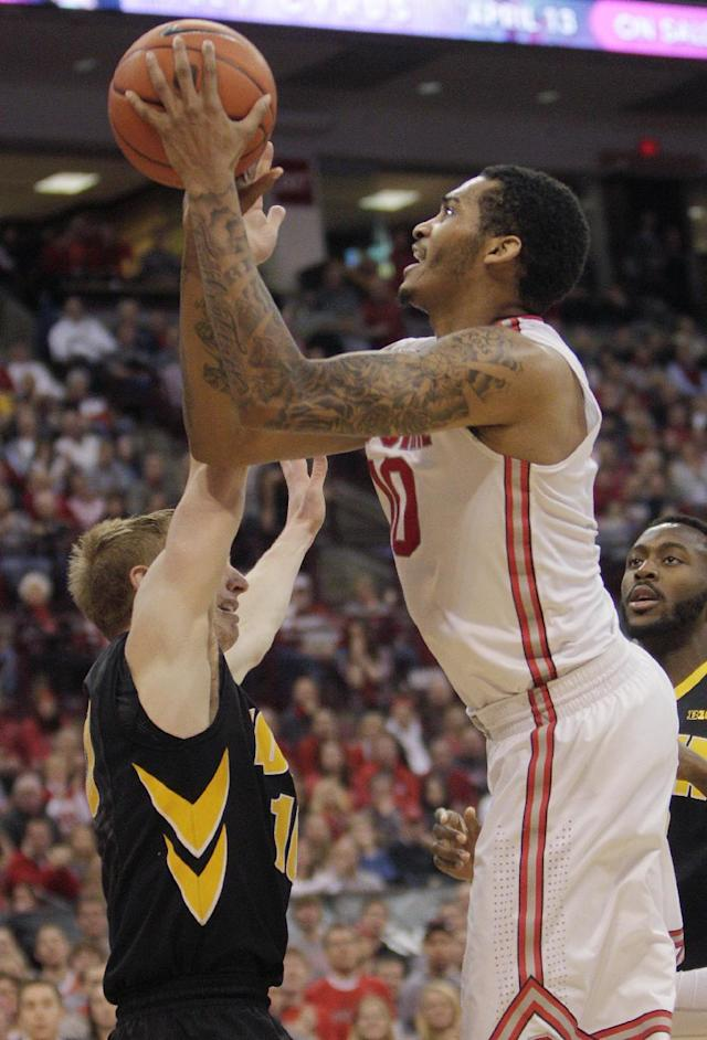 Ohio State's LaQuinton Ross, right, shoots over Iowa's Mike Gesell during the second half of an NCAA college basketball game on Sunday, Jan. 12, 2014, in Columbus, Ohio. Iowa won 84-74. (AP Photo/Jay LaPrete)