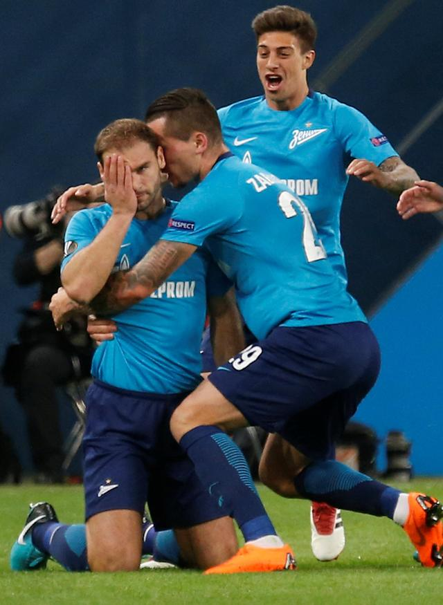 Soccer Football - Europa League Round of 32 Second Leg - Zenit Saint Petersburg vs Celtic - Stadium St. Petersburg, Saint Petersburg, Russia - February 22, 2018 Zenit St. Petersburg's Branislav Ivanovic celebrates with Anton Zabolotny after scoring their first goal REUTERS/Anton Vaganov