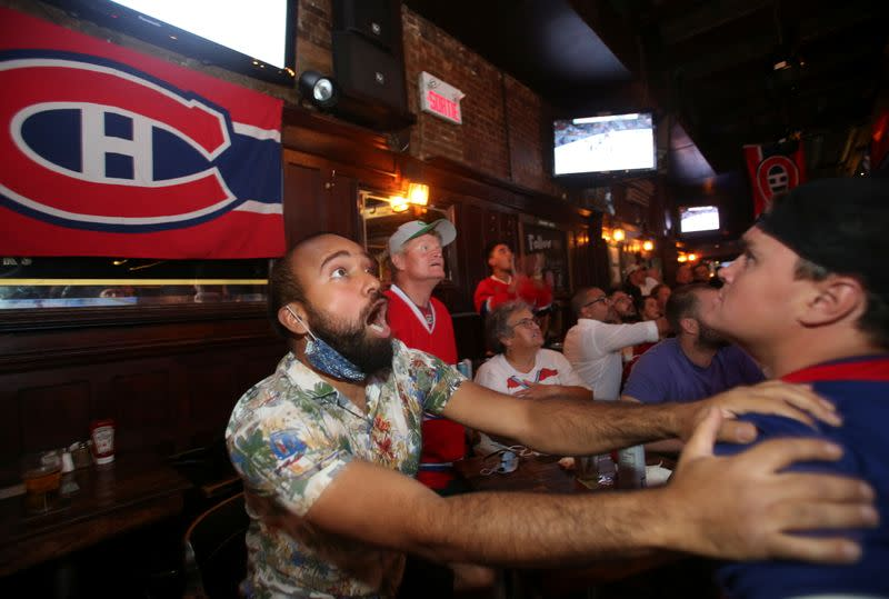 Montreal Canadiens hockey fans react as they watch the second away game of the Stanley Cup Finals