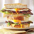 """<p>Piled high with <a href=""""https://www.myrecipes.com/extracrispy/american-cheese-is-perfect"""" rel=""""nofollow noopener"""" target=""""_blank"""" data-ylk=""""slk:creamy American cheese"""" class=""""link rapid-noclick-resp"""">creamy American cheese</a>, fresh lettuce, and crisp BBQ Bacon, this really is the Ultimate Fried Egg Sandwich.</p>"""