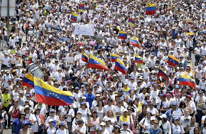 Thousands of women marched in Caracas to keep pressure on President Nicolas Maduro, whose authority is being increasingly challenged by protests and deadly unrest (AFP Photo/FEDERICO PARRA )