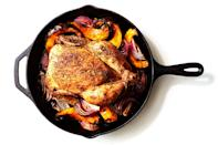 "Why wouldn't you throw some veggies around your bird while it roasts? You've got a hot pan that's about to be full of sizzling schmaltz just begging to bathe a mosaic of squash and onions with tons of chicken-y flavor. <a href=""https://www.epicurious.com/recipes/food/views/cast-iron-roast-chicken-with-winter-squash-red-onions-and-pancetta?mbid=synd_yahoo_rss"" rel=""nofollow noopener"" target=""_blank"" data-ylk=""slk:See recipe."" class=""link rapid-noclick-resp"">See recipe.</a>"