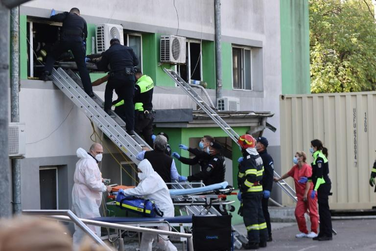 Aeveral patients, some elderly, were carried out through windows as the flames threatened to spread (AFP/Costin Dinca)