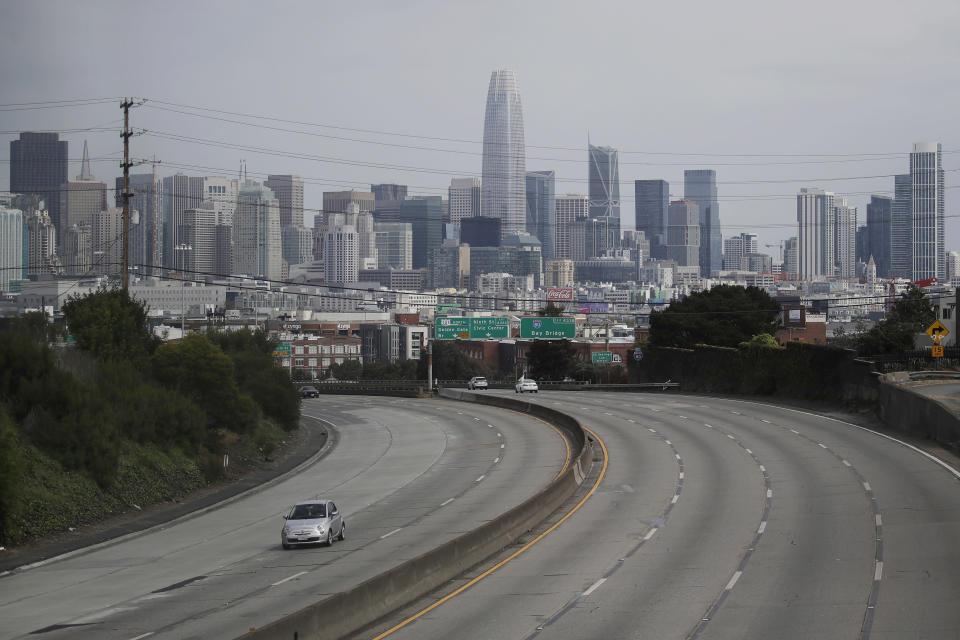 FILE - In this March 29, 2020, file photo, traffic is sparse on Highway 101 in San Francisco amid coronavirus concerns. Citing the unprecedented challenges created by the coronavirus pandemic, city officials across California are asking Gov. Gavin Newsom to suspend or delay numerous state laws, saying they can't comply with everything from environmental regulations to public records laws that allow the public to see how the government spends public money. (AP Photo/Jeff Chiu, File)