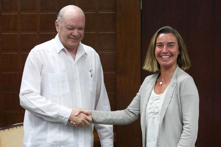 EU foreign policy chief Federica Mogherini shakes hands with Cuba's Minister of Foreign Trade and Investment Rodrigo Malmierca in Havana, Cuba, January 3, 2018. REUTERS/Jorge Luis Banos/Pool