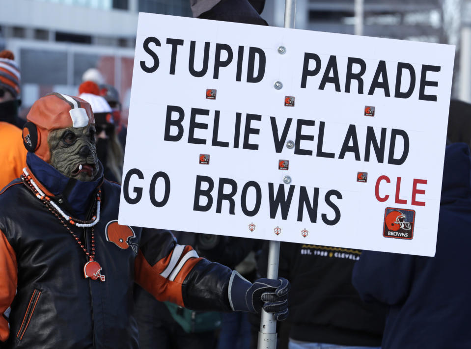 "A Cleveland Browns fan watches the ""Perfect Season"" parade, Saturday, Jan. 6, 2018, in Cleveland. The Browns became the second team in NFL history to lose 16 games in a season. In joining the 2008 Detroit Lions in a shameful loser's club, the Browns have found a new low in what has been nearly two decades of disgrace since returning as an expansion franchise in 1999. (AP Photo/Tony Dejak)"