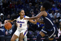 DePaul guard Deja Church (3) dribbles against Connecticut guard Christyn Williams, right, during the first half of an NCAA college basketball game on Monday, Dec. 16, 2019. in Chicago, Ill. (AP Photo/Matt Marton)