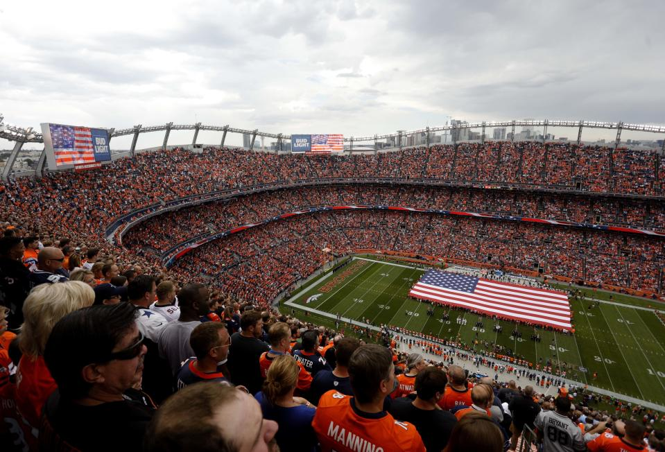 The national anthem, played here Sunday in Denver, at NFL games is part of the debate in NFL TV ratings. (AP)