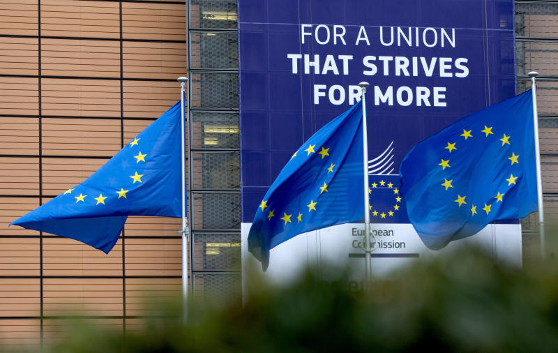 European Union flags flap in the wind outside EU headquarters in Brussels, Monday, Jan. 27, 2020. The U.K. is due to leave the EU on Friday, the first nation in the bloc to do so. It then enters an 11-month transition period in which Britain will continue to follow the bloc's rules while the two sides work out new deals on trade, security and other areas., 2020. (AP Photo/Virginia Mayo)