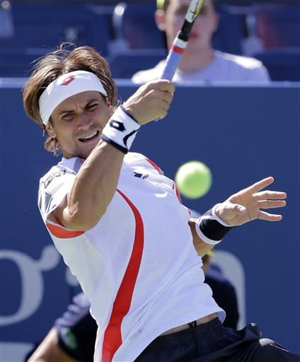 Spain's David Ferrer returns a shot during his match against Kevin Anderson of South Africa in the second round of play at the 2012 US Open tennis tournament, Wednesday, Aug. 29, 2012, in New York. (AP Photo/Mike Groll
