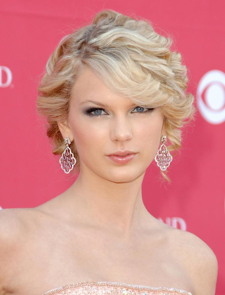 <p>Clearly one for a little romance, Swift swept her soft curls into a romantic updo at the 2007 Academy of Country Music Awards. Blue eye makeup and a glossed pout lent an ethereal feel to her look. </p>