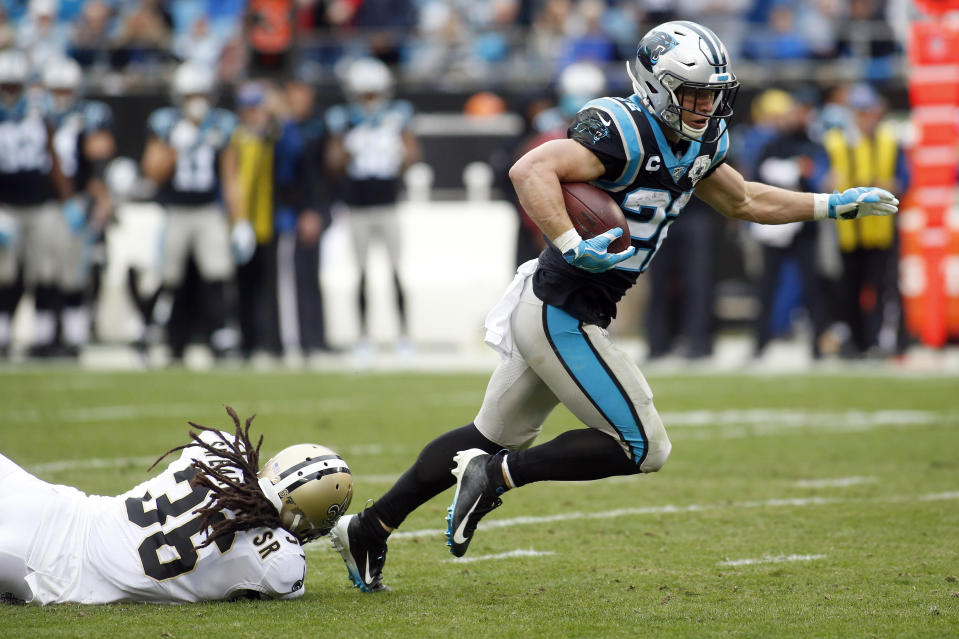 Carolina Panthers running back Christian McCaffrey (22) runs the ball while New Orleans Saints free safety D.J. Swearinger (36) misses the tackle during the first half of an NFL football game in Charlotte, N.C., Sunday, Dec. 29, 2019. (AP Photo/Brian Blanco)