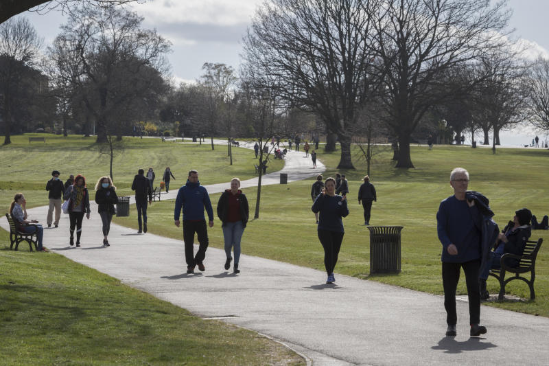 Dozens of Londoners walking in Brockwell Park in south London on Friday. (Getty)