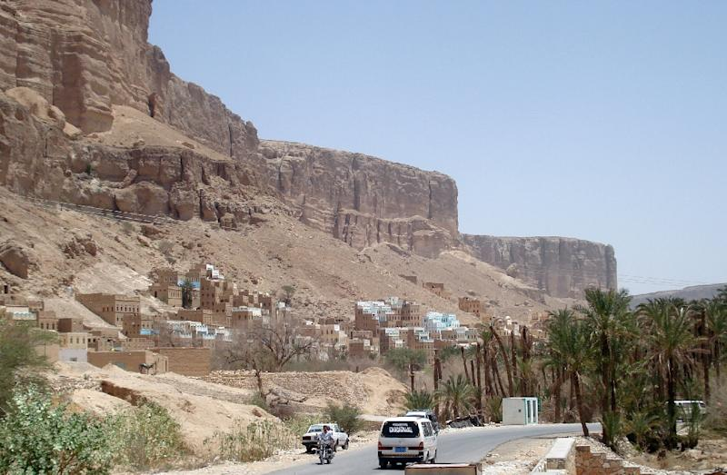 A vehicle drives on a main road in the southern Yemeni province of Hadramawt on on May 9, 2011