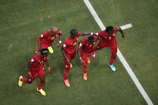 Ghana players dance after Asamoah Gyan, right, scored his side's second goal during the group G World Cup soccer match between Germany and Ghana at the Arena Castelao in Fortaleza, Brazil, Saturday, June 21, 2014. (AP Photo/Francois Xavier Marit, pool)