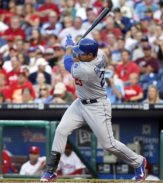 Los Angeles Dodgers' Adrian Gonzalez follows through on a grounder that scored Carl Crawford during the first inning of a baseball game with the Philadelphia Phillies, Saturday, Aug. 17, 2013, in Philadelphia. Gonzalez reached first on an error. (AP Photo/Tom Mihalek)