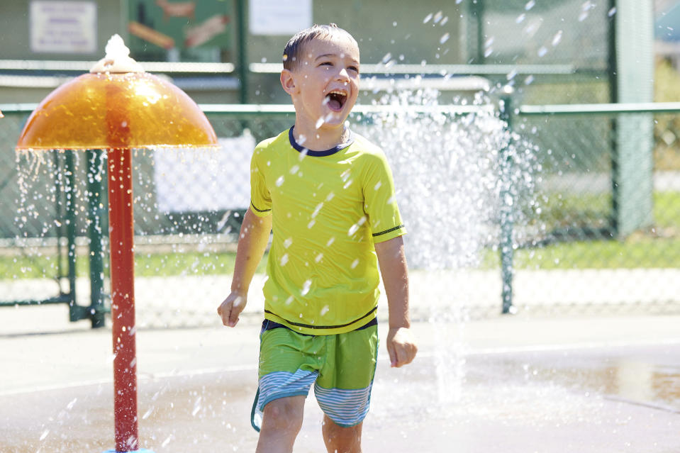 Hunter Sack, 7, runs through the water at Max Patterson park to escape from the heat during a record setting heat wave in Gladstone, Ore., Sunday, June 27, 2021. Yesterday set a record high for the day with more records expected today. (AP Photo/Craig Mitchelldyer)