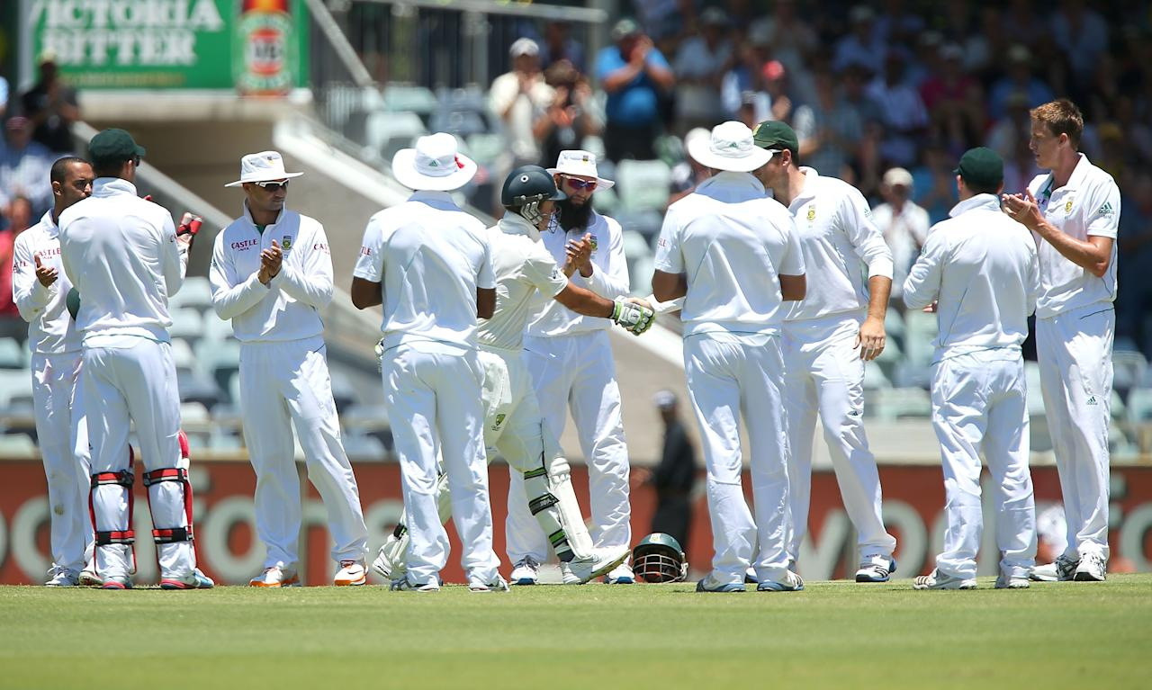 PERTH, AUSTRALIA - DECEMBER 03:  Ricky Ponting of Australia is greeting to the wicket by South African captain Graeme Smith and a guard of honour by the South African players during day four of the Third Test Match between Australia and South Africa at WACA on December 3, 2012 in Perth, Australia.  (Photo by Paul Kane/Getty Images)