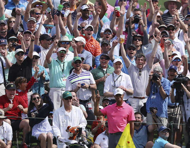 The massive gallery following Tiger Woods reacts as he chips in for an eagle on the second hole during practice for the Masters golf tournament at Augusta National Golf Club, Monday, April 2, 2018, in Augusta, Ga. (AP)