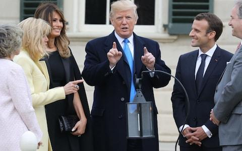 French first lady Brigitte Macron and US first lady Melania Trump listen as US President Donald Trump speaks with French President Emmanuel Macron at Mount Vernon - Credit:  LUDOVIC MARIN/AFP